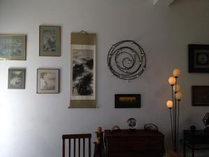 Art from Korea, China and Japan form the entry wall into the loft.