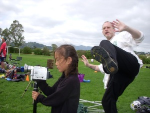 Not what it looks like, I swear! I was doing a slow motion Tai Chi routine, pivoted, and found one of the kids I was teaching to use my video camera had stepped into range :-)
